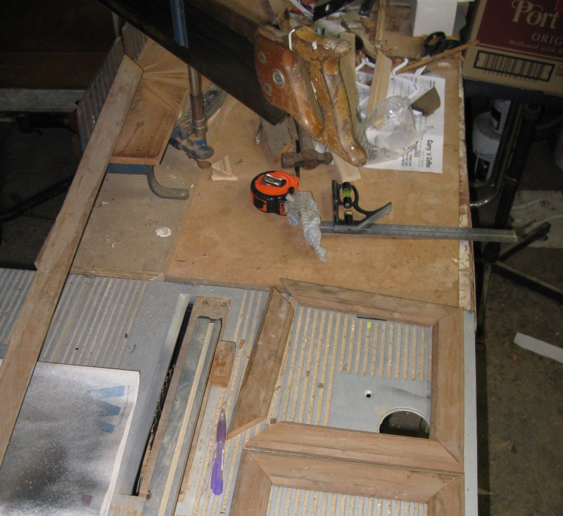 """Make up 2  """"picture frames"""" using mitre saw. The inner dimension should be about the same size as the cat door opening or just slightly bigger. I glued and tacked mine together with small nails."""