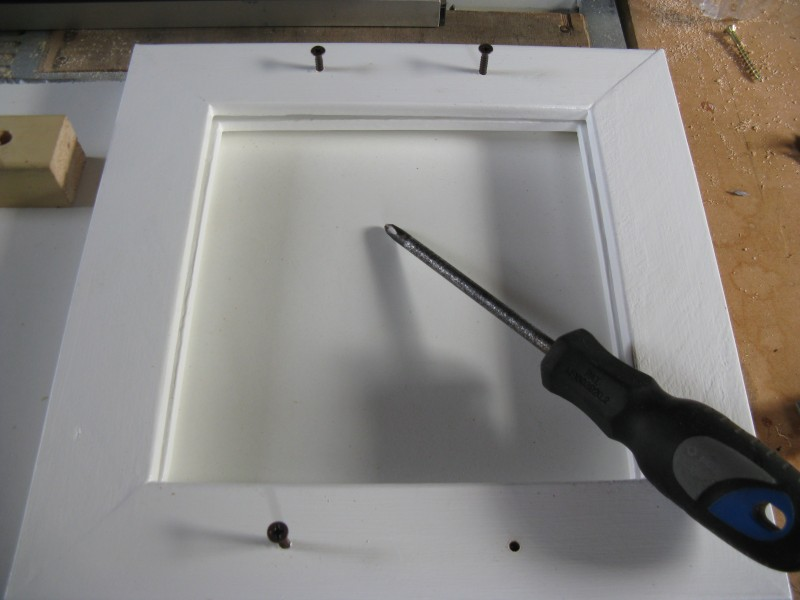 Line up the 2 frames and screw the screws through into the frame you didn't drill
